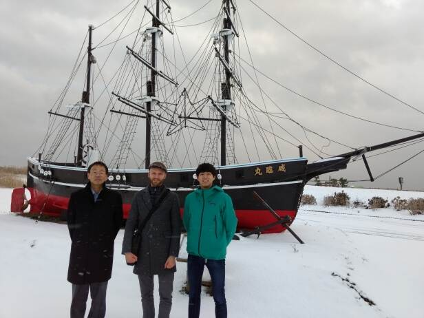 Posing in front of the Kanrin Maru model monument.